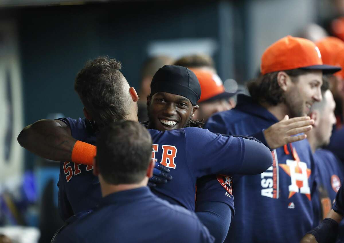 Houston Astros Cameron Maybin (3) hugs George Springer (4) after Maybin's three-run home run during the third inning of an MLB baseball game at Minute Maid Park, Sunday, Sept. 3, 2017, in Houston. ( Karen Warren / Houston Chronicle )