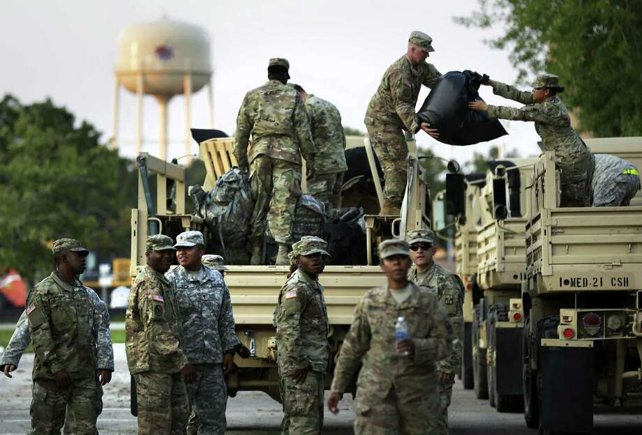 Members of the 49th Transportation Battalion and 1ST Medical Brigade unload supplies in Wharton, Tx on Friday, Sept. 1, 2017. Photo: Photos By Bob Owen / San Antonio Express-News / ©2017 San Antonio Express-News