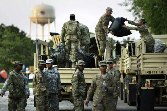 Members of the 49th Transportation Battalion and 1ST Medical Brigade unload supplies in Wharton, Tx on Friday, Sept. 1, 2017.