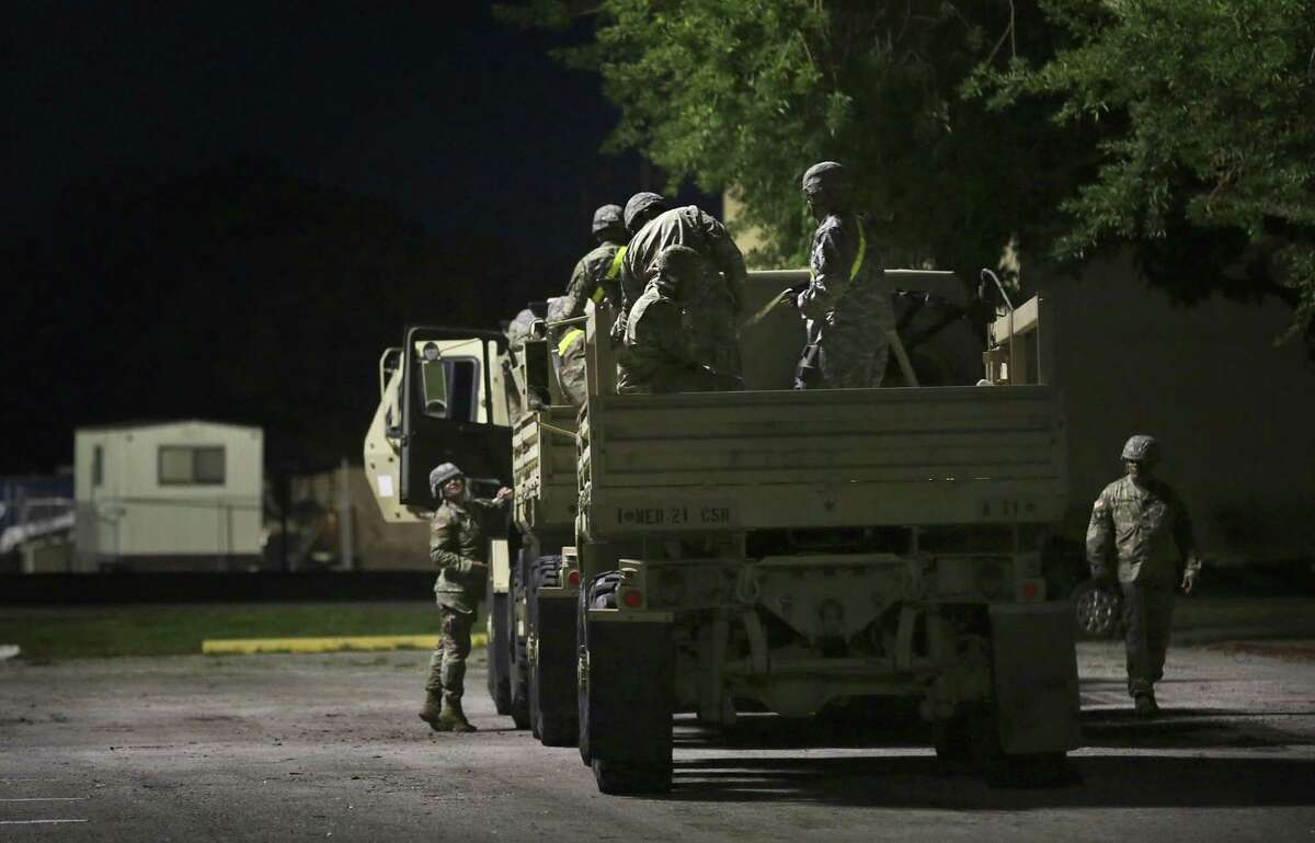 Members of the 49th Transportation Battalion and 1ST Medical Brigade prepare to go on a search and rescue mission in Wharton, Tx on Friday, Sept. 1, 2017.