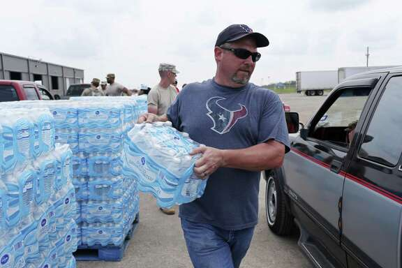 Brad Graybill, of Eddy, Texas, volunteers at a distribution center at the Victoria Community Center in Victoria, Texas, Sunday, Sept. 3, 2017. Hurricane Harvey hit the area hard last week and many areas are still without water or electricity.