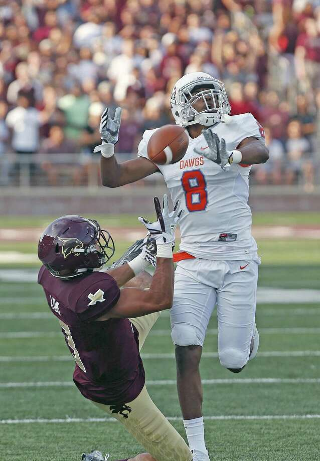 Bobcats's Elijah King catches a long pass as Houston Baptist Raphael Lewis defends in season-opening for Texas State v Houston Baptist on Saturday, September 2 ,2017 Photo: Ron Cortes, Freelance / For The San Antonio Express-News