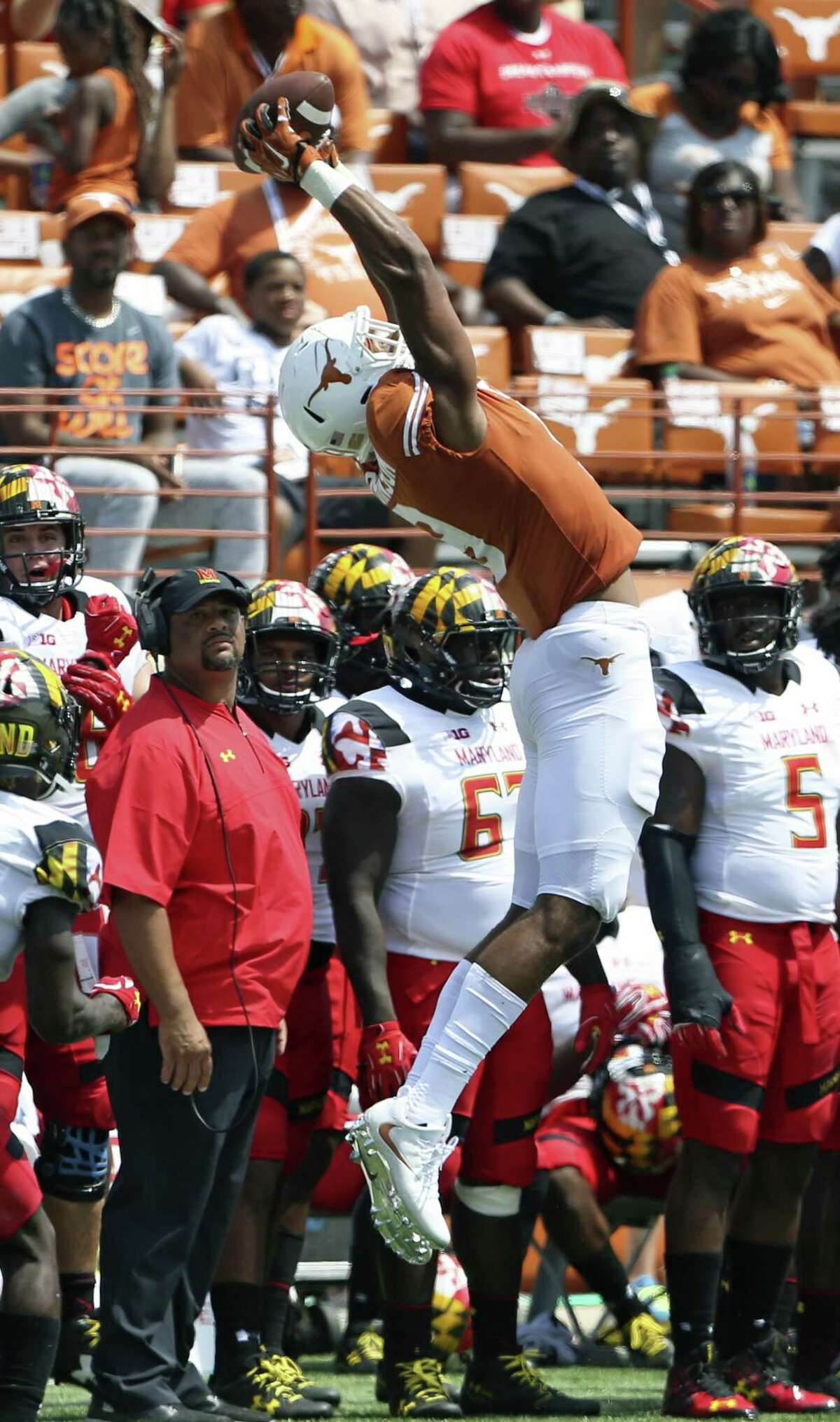 Longhorn receiver Collin Johnson goes high to haul in a pass to the sideline as Texas plays Maryland at DKR Stadium on September 2, 2017.