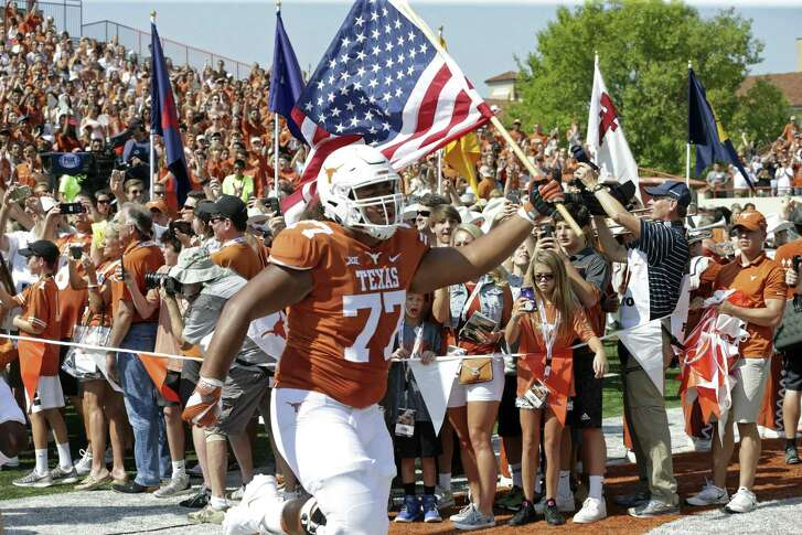 Patrick Vahe leads the team out onto the field as Texas plays Maryland at DKR Stadium on September 2, 2017.