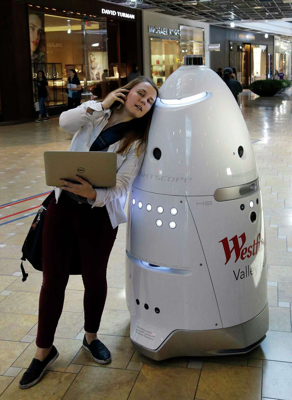 ADVANCE FOR RELEASE MONDAY, SEPT. 4, 2017, AT 12:01 A.M. EDT - In this Monday, June 26, 2017, photo, Knightscope Inc. deployment engineer Gale Curry field checks a K5 security robot at Westfield Valley Fair shopping center in San Jose, Calif. A San Francisco supervisor is calling for a tax on robots that automate jobs and put people out of work, saying the money should be used to help the unemployed. (AP Photo/Ben Margot) ORG XMIT: NYBZ602