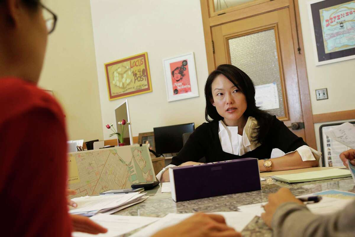 ADVANCE FOR RELEASE MONDAY, SEPT. 4, 2017, AT 12:01 A.M. EDT - In this June 26, 2017, photo, city supervisor Jane Kim talks to members of her staff as she is interviewed at City Hall in San Francisco. Kim is calling for a tax on companies that automate jobs once held by people. (AP Photo/Jeff Chiu) ORG XMIT: NYBZ603
