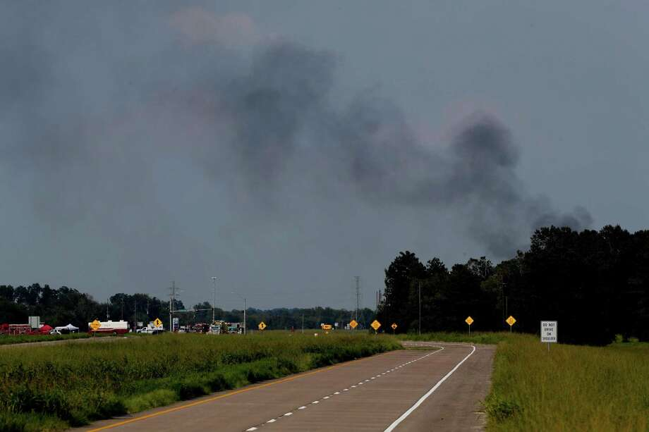 "Smoke rising from the Arkema Inc. plant in Crosby on Sunday signaled an end to the waiting game that had left citizens of nearby cities worried. ""We've been on pins and needles,"" said Newport resident, John Rull. Photo: Steve Gonzales, Staff Photographer / Houston Chronicle"