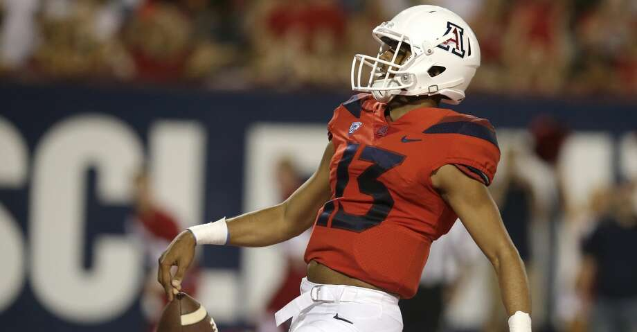 Arizona quarterback Brandon Dawkins is a player to watch in UH's game on Saturday. Photo: Rick Scuteri/Associated Press