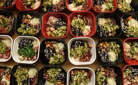 Buddha bowls are plated in the kitchen for lunch during the So Buddhalicious Vegan Day Retreat at The Red Robin Song Guest House on Saturday, Aug. 26, 2017 in West Lebanon, N.Y. The bowls consisted of food such as rice, beans, sweet potato, and kale with a cashew based cream drizzled on top. (Lori Van Buren / Times Union)