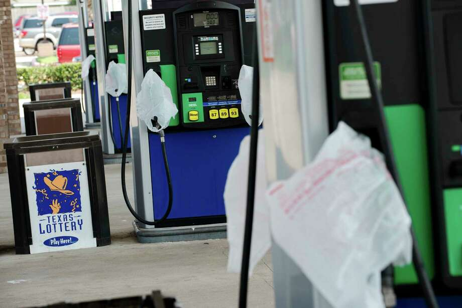 Plastic bags indicate no gasoline at a RaceWay gas station in Houston, Sept. 1, 2017. Nationally, the average price of a gallon of regular gasoline continues to hit new highs for the year, and there are some tentative signs the oil industry is making progress to get back on its feet. (Bryan Thomas/The New York Times) Photo: BRYAN THOMAS, STR / NYTNS