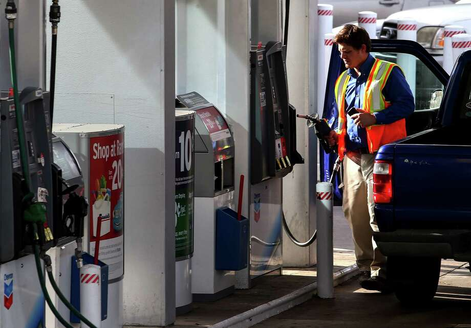 A man pumps gas at a Galleria-area gas station, Tuesday, Jan. 3, 2017, in Houston. ( Jon Shapley / Houston Chronicle ) Photo: Jon Shapley, Staff / © 2015  Houston Chronicle