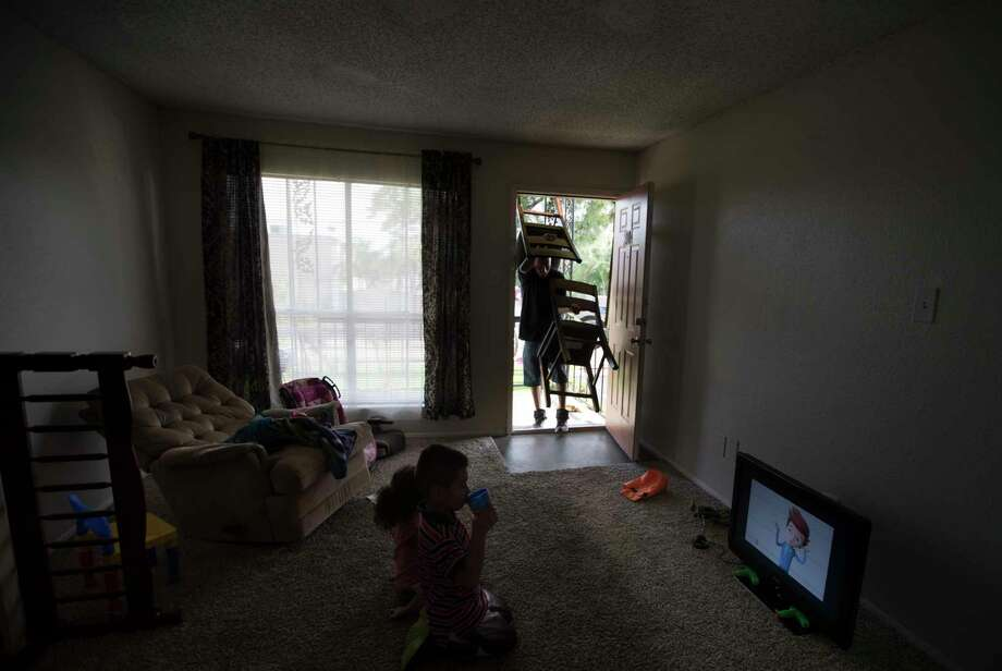 Byron Soto, 31, carries dinning room chairs inside the apartment, Thursday, Aug. 31, 2017, in Houston, where he and his family will relocate temporarily because their previous apartment got flooded Friday during the rains provoked by the Tropical Storm Harvey. Photo: Marie D. De Jesus, Staff / © 2017 Houston Chronicle