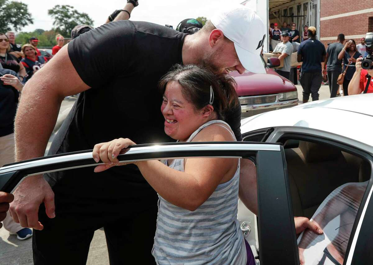 Elvira Vera jumps out of her car to embrace Houston Texans defensive end J.J. Watt as he distributing relief supplies to people impacted by Hurricane Harvey on Sunday, Sept. 3, 2017, in Houston. J.J. Watt's Hurricane Harvey Relief Fund, which raised more than $17 million to date to help those affected by the storm.