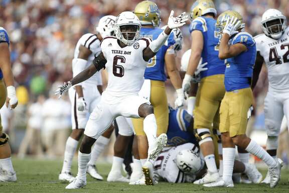 Texas A&M defensive back Donovan Wilson celebrates after teammate defensive back Myles Jones (not shown) recovered a fumble by UCLA running back Bolu Olorunfunmi during the first quarter of an NCAA college football game, Sunday, Sept. 3, 2017, in Pasadena, Calif. (AP Photo/Danny Moloshok)