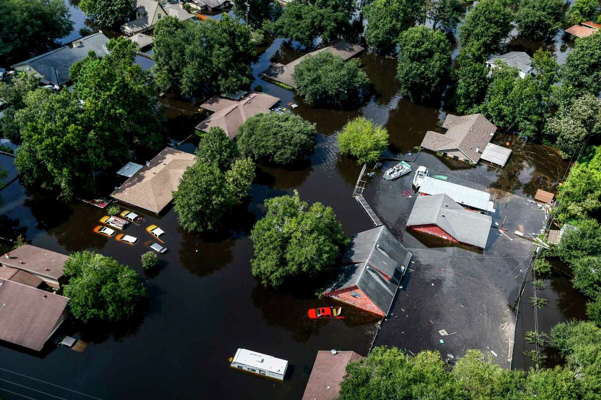 Harvey's floodwaters envelop houses in Vidor. The national flood insurance program is running a deficit.