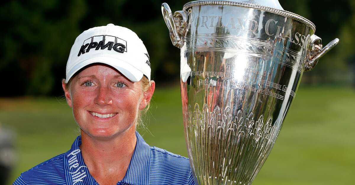 PORTLAND, OR - SEPTEMBER 03: Stacy Lewis poses wth the winner's trophy on the 18th green after her victory during the final round of the LPGA Cambia Portland Classic at Columbia Edgewater Country Club on September 3, 2017 in Portland, Oregon. (Photo by Jonathan Ferrey/Getty Images)