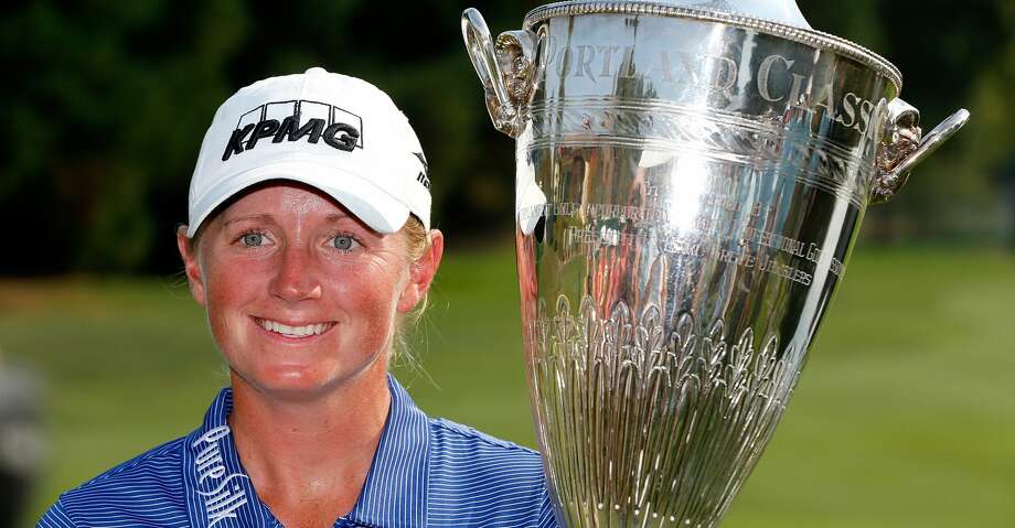 PORTLAND, OR - SEPTEMBER 03:  Stacy Lewis poses wth the winner's trophy on the 18th green after her victory during the final round of the LPGA Cambia Portland Classic at Columbia Edgewater Country Club on September 3, 2017 in Portland, Oregon.  (Photo by Jonathan Ferrey/Getty Images) Photo: Jonathan Ferrey/Getty Images