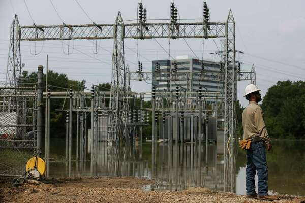 CenterPoint Energy lineman Jeff Faulkner stands near a flooded substation that crews are working to bring back online to restore power to affected customers Sunday, Sept. 3, 2017 in Houston. ( Michael Ciaglo / Houston Chronicle)
