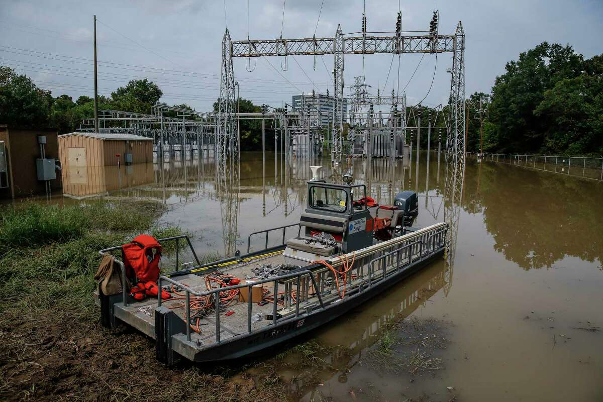 A CenterPoint Energy boat sits at a flooded substation that crews are working to bring back online to restore power to affected customers Sunday, Sept. 3, 2017 in Houston. ( Michael Ciaglo / Houston Chronicle)