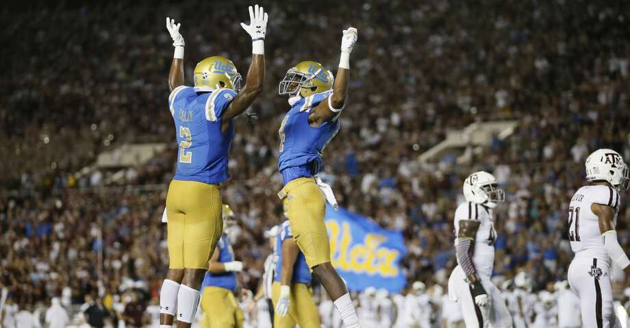 UCLA wide receiver Theo Howard, right, celebrates scoring a touchdown with UCLA wide receiver Jordan Lasley, left, late in the fourth quarter against Texas A&M in an NCAA college football game, Sunday, Sept. 3, 2017, in Pasadena, Calif. UCLA won 45-44. (AP Photo/Danny Moloshok) Photo: Danny Moloshok/Associated Press