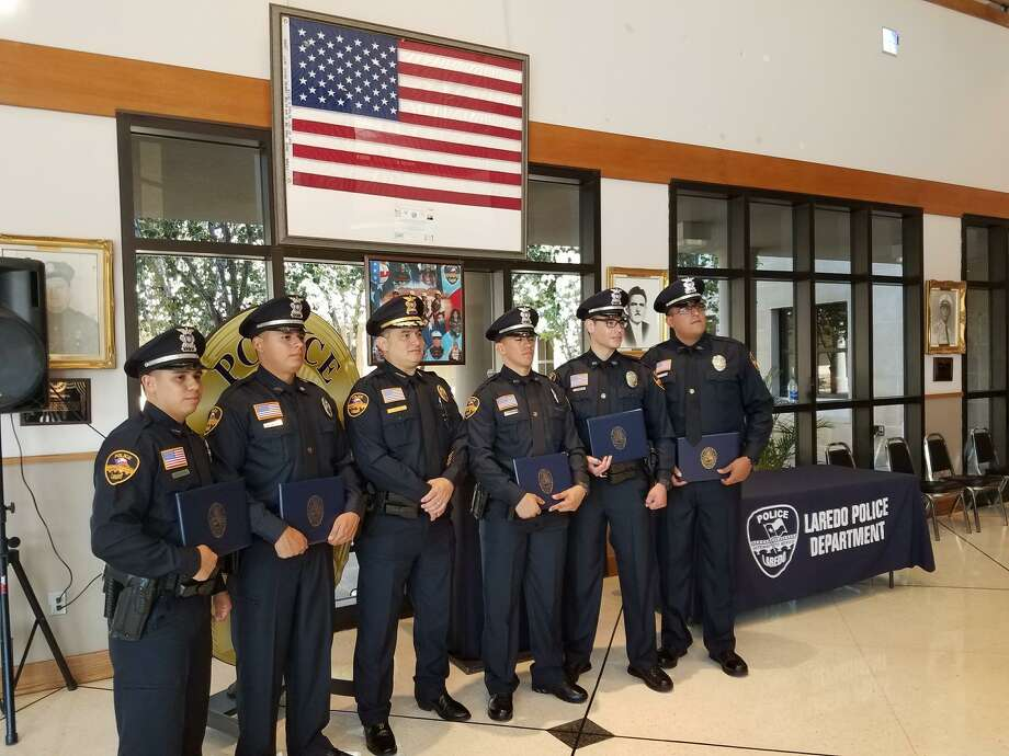 Laredo Police Chief Claudio Treviño Jr. poses for a photo with the officers sworn in to serve and protect the community of Laredo on Friday. Photo: Courtesy Photo /Laredo Police Department