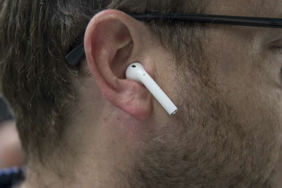 FILE — An attendee wears Apple Inc. AirPod wireless headphones during an event in San Francisco, California, U.S., on Wednesday, Sept. 7, 2016. A man alleged that one of his AirPods exploded at a Florida gym last week. Photo: David Paul Morris
