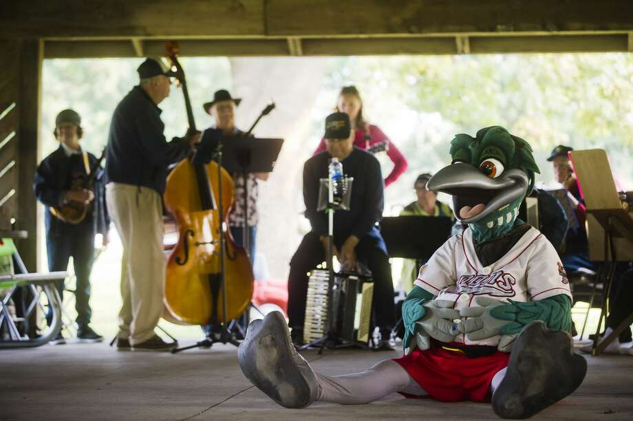 Lou E. Loon listens as Midland Mayor Maureen Donker speaks during the annual Labor Day Tridge Walk event on Monday, September 4, 2017 in Midland's Chippewassee Park. Although attendees were unable to walk across the tridge this year due to construction, the event was still held and featured performances by the Resonators Drum Line and Jolly Hammers & Strings of the Folk Music Society of Midland. Photo: (Katy Kildee/kkildee@mdn.net)