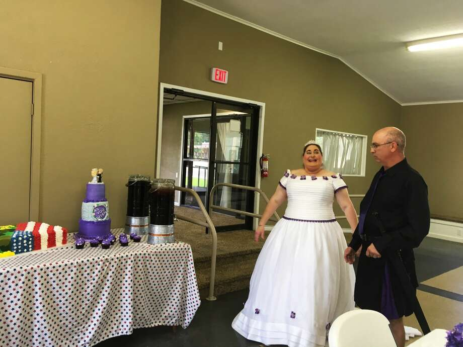 After multiple delays in their wedding, Jay and Karon Hermann got married Sunday and invited the Silsbee Police Department and members of the National Guard to eat the pulled pork, brisket and wedding cakes the couple prepared for the wedding. Photo: Tim Collins
