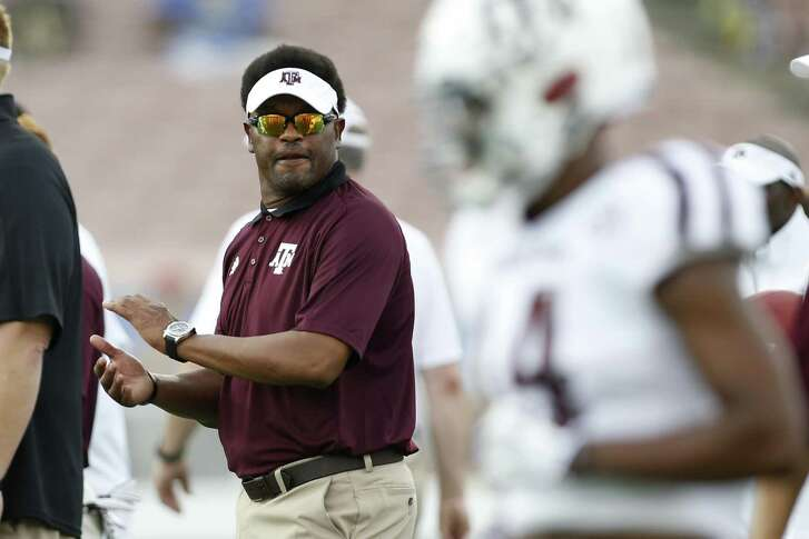 Texas A&M coach Kevin Sumlin watches his team warm up before the game against UCLA on Sept. 3, 2017, at the Rose Bowl in Pasadena, Calif.
