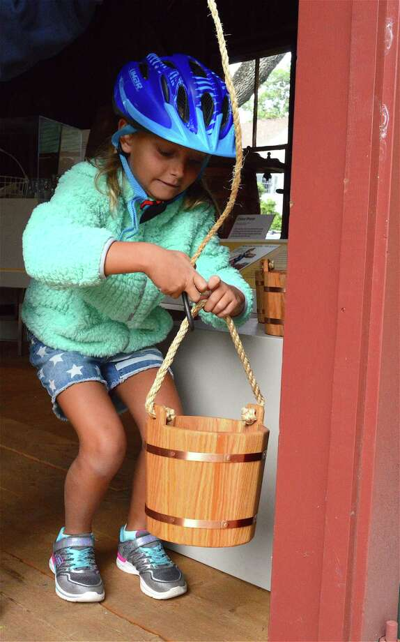 Olivia Parise, 7, of Fairfield, checks out an old-fashioned kitchen sink at the Fairfield Museum & History Center, Saturday, Sept. 2, 2017, in Fairfield, Conn. Photo: Jarret Liotta / For Hearst Connecticut Media / Fairfield Citizen News Freelance