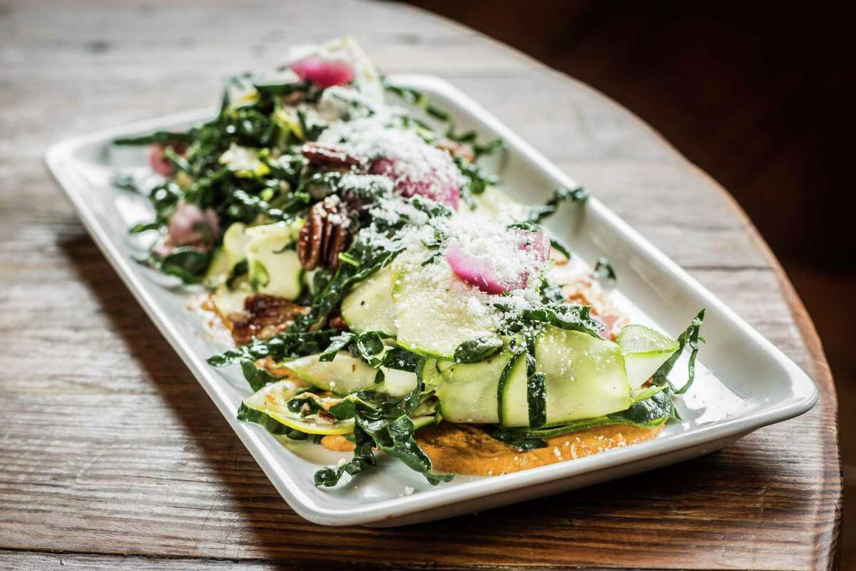 Summer squash crudo with kale, pickled pearl onions, pecorino, herbs, pecans and romesco at Coltivare