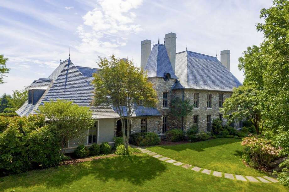 The stone and stucco Tudor house with a slate roof at 945 Sasco Hill Road has 21 rooms and 14,914 square feet of living space on more than six acres near Long Island Sound.