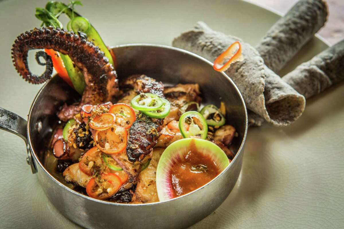 Hugo's Pulpo al Carbon: grilled octopus, onions, peppers, and chipotle-tomatillo salsa served with homemade tortillas at Hugo's.