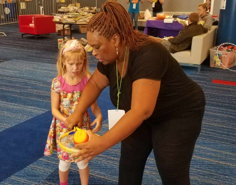 Tennis legend Zina Garrison leads a tennis clinic for children evacuees  at George R. Brown Convention Center on Saturday, Sept. 2, 2017. Photo: Joy Sewing