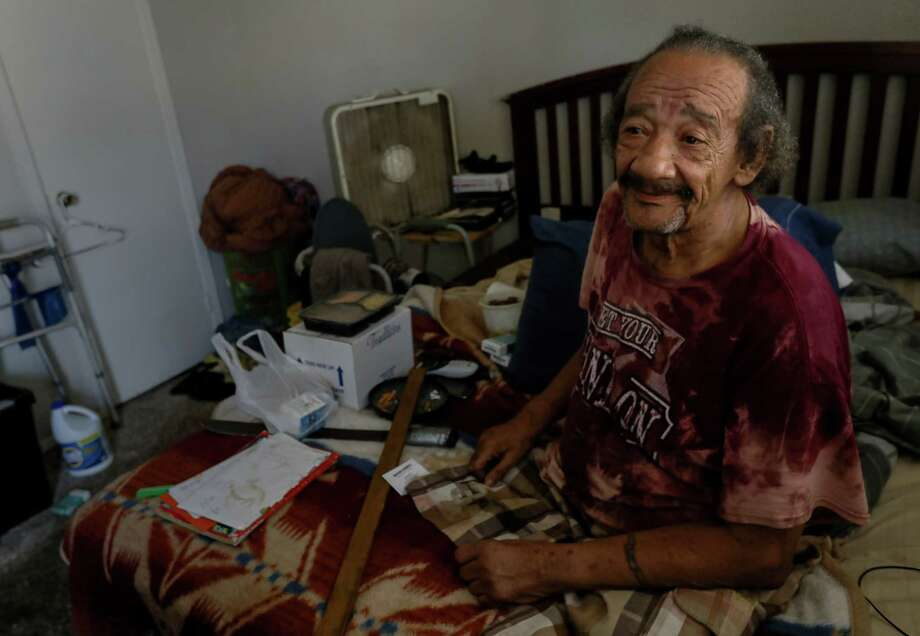 Willmon Guillory, a 68-year-old who lost both of his legs to diabetes, sits in his apartment during a food delivery by Meals on Wheels. Willmon rode out Tropical Storm Harvey in the apartment, and had water come in from his roof. Photo: Jon Shapley, Houston Chronicle / © 2017 Houston Chronicle