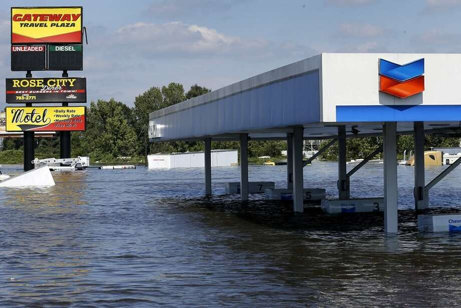 A gas station submerged under flood waters in Tropical Storm Harvey is seen in Rose City, Texas. Photo: Thomson Reuters