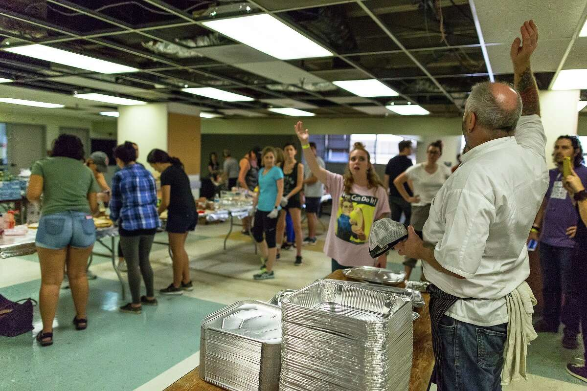 The Midtown Kitchen Collective (in the former SEARCH Homeless Services building at 2505 Fannin) has been turned into a collaborative volunteer effort to prepare, source and distribute food to Harvey victims across the region. Shown: scenes from the food efforts at the collective.