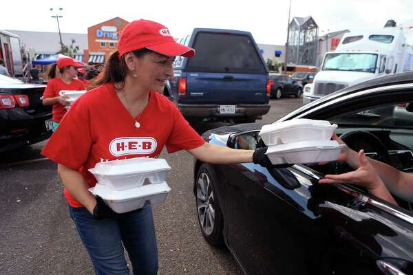H-E-B employee Michelle Aquas distributes meals to Aransas Pass residents from H-E-B's Disaster Response Unit on Tuesday, Aug. 29, 2017, in Rockport, Texas.