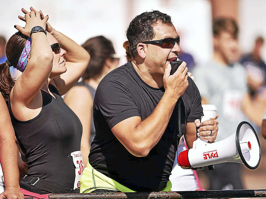 Fans and participants cheer on runners at the finish line, Monday, Sept. 4, 2017, at the 40th annual New Haven Road Race and 20K Championship in New Haven, Connecticut. Photo: Catherine Avalone/Hearst Connecticut Media / New Haven Register