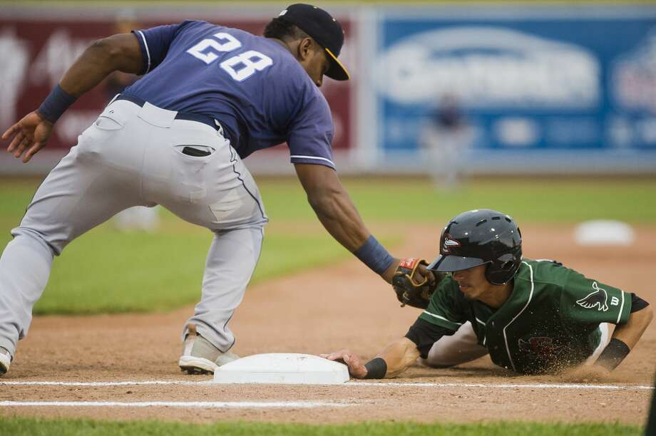 Great Lakes Loons second baseman Moises Perez slides back into first base as Lake County Captains first baseman Emmanuel Tapia tries to tag him out during their game on Monday, September 4, 2017 at Dow Diamond. Photo: (Katy Kildee/kkildee@mdn.net)
