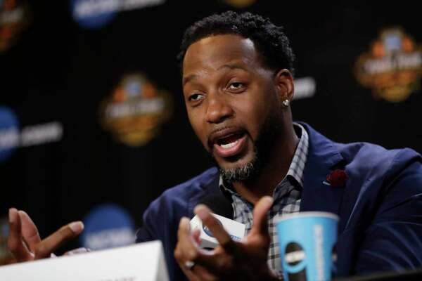 Tracy McGrady answers questions at the Basketball Hall of Fame news conference, Saturday, April 1, 2017, in Glendale, Ariz. (AP Photo/David J. Phillip)