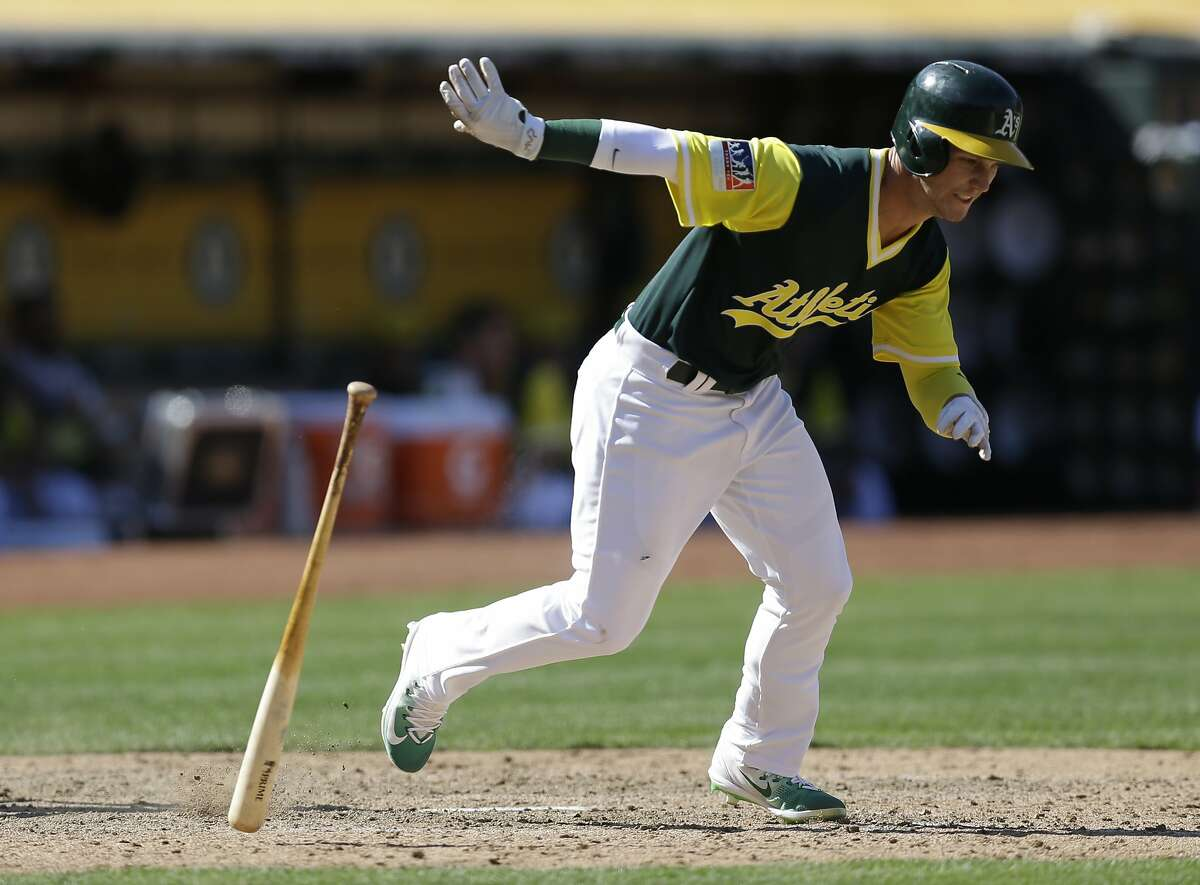 Oakland Athletics' Boog Powell tosses his bat after hitting an RBI-single against the Texas Rangers in the eighth inning of a baseball game Sunday, Aug. 27, 2017, in Oakland, Calif. (AP Photo/Ben Margot)