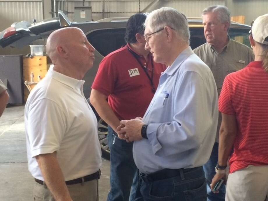 U.S. Rep. Kevin Brady and Conroe Mayor Toby Powell discuss Harvey relief efforts at a distribution center in Conroe on Monday. (Photo by John S. Marshall) Photo: John S. Marshall