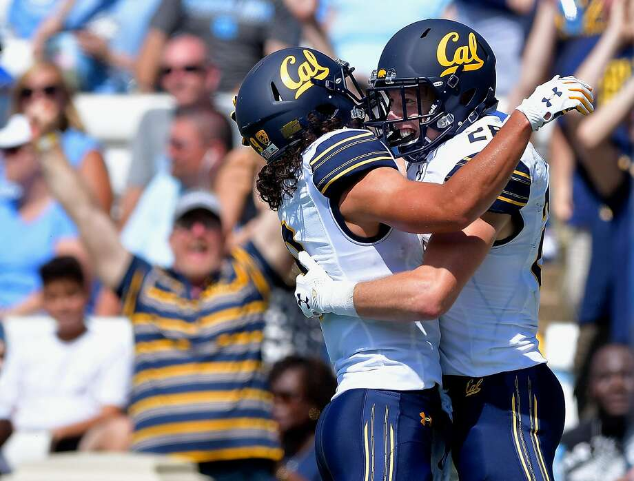 CHAPEL HILL, NC - SEPTEMBER 02:  Patrick Laird #28 celebrates with teamate Kanawai Noa #9 of the California Golden Bears after scoring on a 54-yard pass against the North Carolina Tar Heels during their game at Kenan Stadium on September 2, 2017 in Chapel Hill, North Carolina. CFal won 35-30.  (Photo by Grant Halverson/Getty Images) *** BESTPIX *** Photo: Grant Halverson