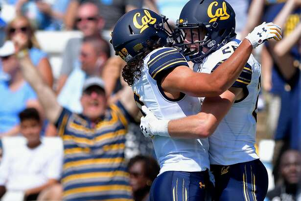 CHAPEL HILL, NC - SEPTEMBER 02:  Patrick Laird #28 celebrates with teamate Kanawai Noa #9 of the California Golden Bears after scoring on a 54-yard pass against the North Carolina Tar Heels during their game at Kenan Stadium on September 2, 2017 in Chapel Hill, North Carolina. CFal won 35-30.  (Photo by Grant Halverson/Getty Images) *** BESTPIX ***