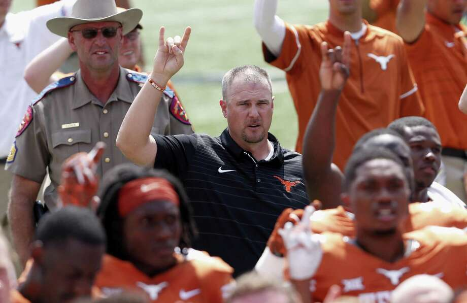 "Coach Tom Herman of the Texas Longhorns sings the ""Eyes of Texas"" following a loss to the Maryland Terrapins at Royal-Memorial Stadium on Sept. 2, 2017 in Austin. Photo: Tim Warner /Getty Images / 2017 Getty Images"