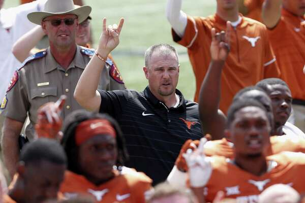"Coach Tom Herman of the Texas Longhorns sings the ""Eyes of Texas"" following a loss to the Maryland Terrapins at Royal-Memorial Stadium on Sept. 2, 2017 in Austin."