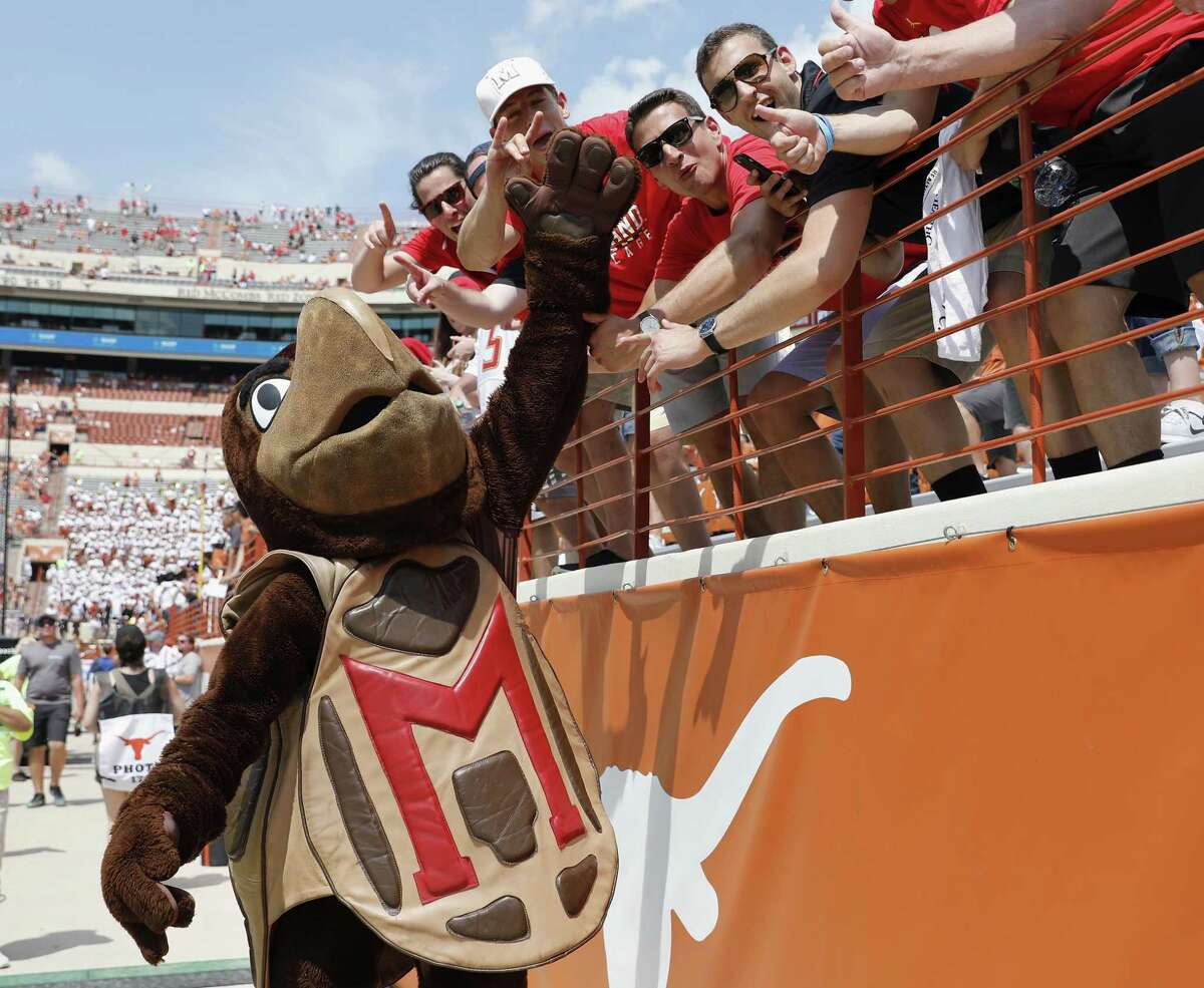 The Maryland Terrapins mascot celebrates with fans in the fourth quarter against the Texas Longhorns at Royal-Memorial Stadium on Sept. 2, 2017 in Austin.