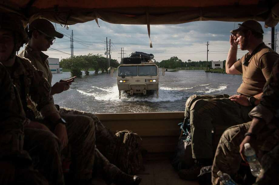 Soldiers with the Texas National GuardÕs 1st Battalion, 143rd Infantry Regiment on their way to a rescue mission in Port Arthur, Texas, Aug. 31, 2017. The storm dropped 47 inches of rain in the Beaumont-Port Arthur area, and most roads into the cities remain impassable, making relief shipments of bottled water difficult. (Erin Trieb/The New York Times) Photo: ERIN TRIEB, STR / NYT / NYTNS