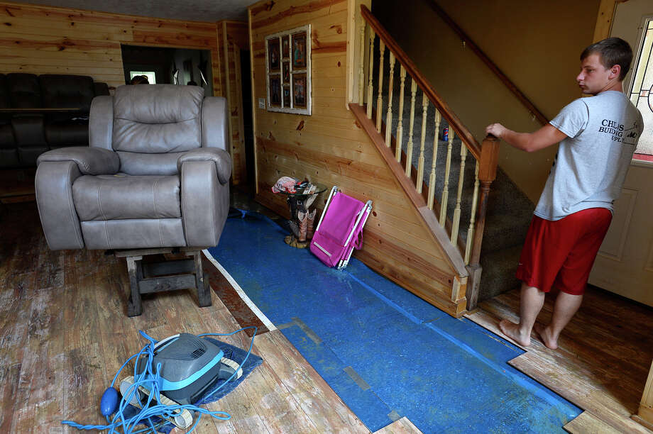 Ryan Williams stands in the living room of his family's home in Deweyville on Monday. The family had to rebuild the first floor of the house after the 2016 flood.  Photo taken Monday 9/4/17 Ryan Pelham/The Enterprise Photo: Ryan Pelham / ©2017 The Beaumont Enterprise/Ryan Pelham